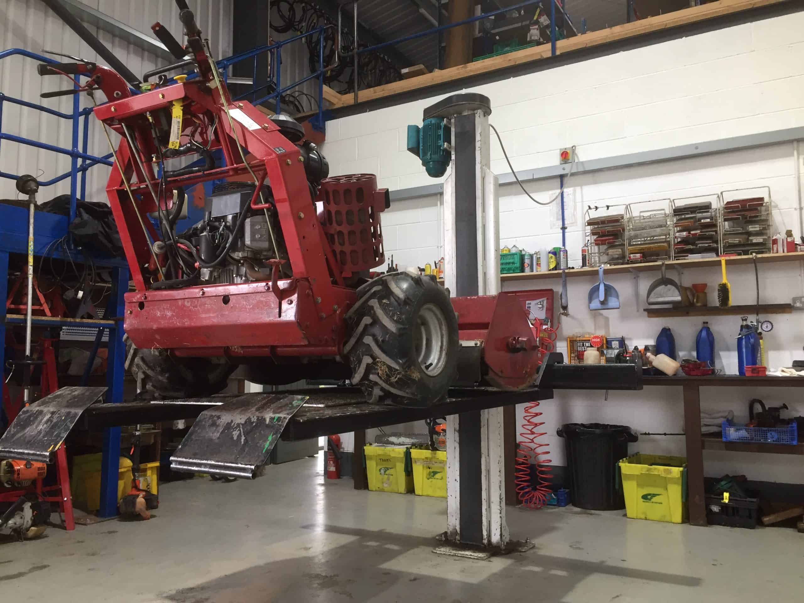 horticultural machinery up on ramp for repair